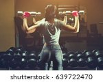 slim bodybuilder girl lifts... | Shutterstock . vector #639722470