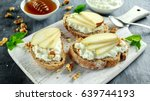 appetizer bruschetta with pear  ... | Shutterstock . vector #639744193