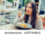 Young Woman Enjoying Food In A...