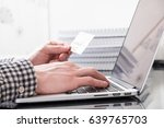 hand holds credit card and... | Shutterstock . vector #639765703