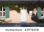 door of a home covered by ivy | Shutterstock . vector #63978358