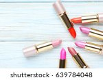 colorful lipsticks on blue...   Shutterstock . vector #639784048