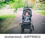 baby girl sitting on stroller... | Shutterstock . vector #639790810