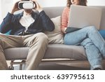 young couple using electronic... | Shutterstock . vector #639795613