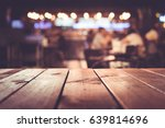 wood table top with blur light... | Shutterstock . vector #639814696