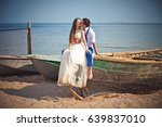 wedding couple in a boat on the ... | Shutterstock . vector #639837010