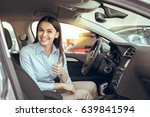 young woman in a car rental... | Shutterstock . vector #639841594