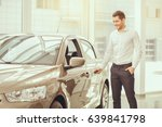 young man in a car rental... | Shutterstock . vector #639841798