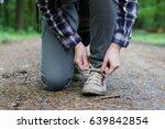 a hiking woman binds tourist... | Shutterstock . vector #639842854
