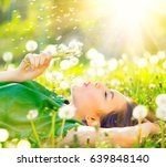 beautiful young woman lying on... | Shutterstock . vector #639848140