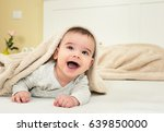 Happy Baby Boy In Bed With A...