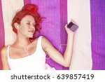 relaxed woman listening to... | Shutterstock . vector #639857419