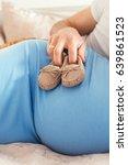 little baby slippers on... | Shutterstock . vector #639861523