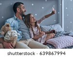 selfie time  young father and... | Shutterstock . vector #639867994