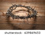 crown of thorns on wooden table   Shutterstock . vector #639869653