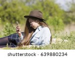 mobile phone in the hands of a... | Shutterstock . vector #639880234