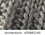 Small photo of highly detailed needlework wool fabric, close up wool texture background.