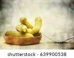 pickled green gherkins  | Shutterstock . vector #639900538