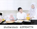 young wife pouring orange juice ... | Shutterstock . vector #639904774