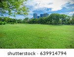 green grass field in park at... | Shutterstock . vector #639914794