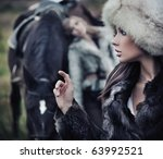 Two romantic female models posing with a horse - stock photo