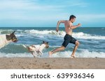 Stock photo guy running away from angry dogs dogs chases to bite 639936346