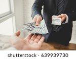 businessman giving money  us... | Shutterstock . vector #639939730