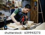 young professional carpenter... | Shutterstock . vector #639943273