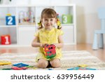 child preschooler girl plays... | Shutterstock . vector #639956449