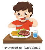 a cute boy is eating steak with ... | Shutterstock .eps vector #639982819