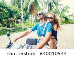 young beautiful couple rides... | Shutterstock . vector #640010944