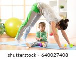mother doing yoga or fitness... | Shutterstock . vector #640027408