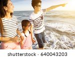 happy family walking on the... | Shutterstock . vector #640043203