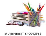 notebook with glasses and set...