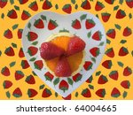 Strawberries and Orange beautifully slices on a heart plate with pattern background. - stock photo