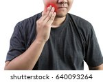man touching his cheek tooth... | Shutterstock . vector #640093264