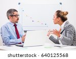 Small photo of Business people are arguing in their office.