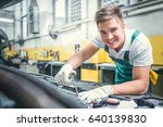 smiling mechanic in service | Shutterstock . vector #640139830
