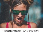 a girl under a summer rain | Shutterstock . vector #640149424