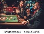 Upper Class Couple Gambling In...