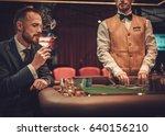 upper class man gambling in a... | Shutterstock . vector #640156210