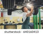 young mechanic in garage | Shutterstock . vector #640160413
