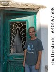 Small photo of Amorgos Island, Greece - October 2015: Portrait of a local man, an Alchemist of Essential oils