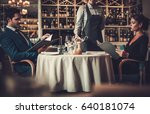 couple reading menu in a... | Shutterstock . vector #640181074