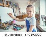 smiling girl in painting studio | Shutterstock . vector #640193020