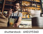 young male bartender preparing... | Shutterstock . vector #640195360