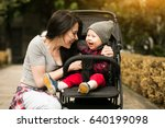 mother and son stroller | Shutterstock . vector #640199098