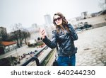 a young and attractive woman... | Shutterstock . vector #640244230