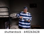 angry male prisoner wearing... | Shutterstock . vector #640263628