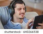 handsome guy listening to music ...   Shutterstock . vector #640266538